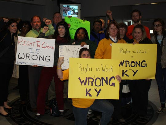 Members of different unions gathered in the Boone County Administration Buliding lobby with their signs opposing right-to-work legislation.