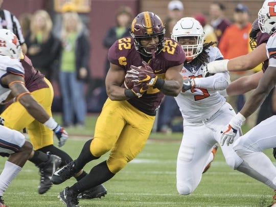 Oct 21, 2017; Minneapolis, MN, USA; Minnesota Golden Gophers running back Kobe McCrary (22) rushes with the ball in the second half against the Illinois Fighting Illini at TCF Bank Stadium.