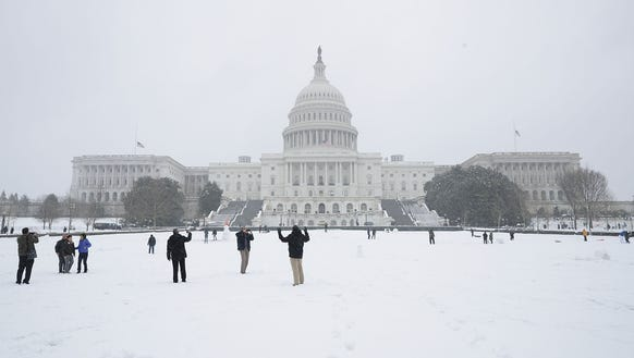 Snow blankets the West Lawn of the U.S. Capitol March