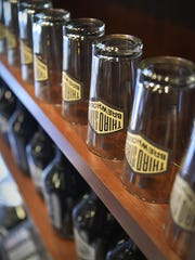 Glasses and growlers are lined up, ready for use at Third Street Brewhouse in Cold Spring.