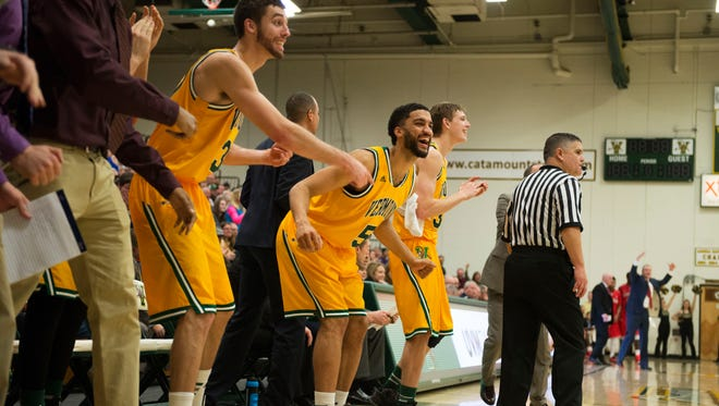 Vermont forwards Hector Harold (5) and Ethan O'Day (32) cheer on their team from the bench during an America East men's basketball game at Patrick Gym earlier this season. The Catamounts improved to 8-2 in the league with a 68-49 win over Maine on Tuesday night.