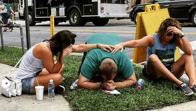 This photo, courtesy of the Instagram site the_pixel_trappa, shows people mourning for victims of the mass shooting near the Pulse gay nightclub in Orlando, Florida, on June 12, 2016.