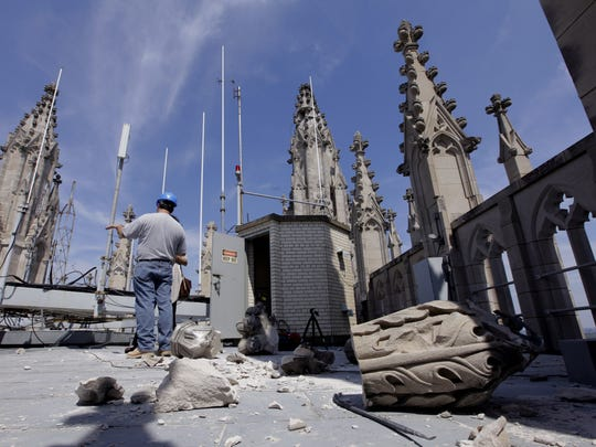 Damage to the Washington National Cathedral is examined the day after a 5.8 magnitude earthquake shook Washington and much of the East Coast, Wednesday, Aug. 24, 2011.