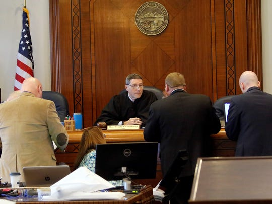 Prosecutors and defense attorneys confer with Ashland County Common Please Court Judge Ron Forsthoefel on Monday, April 23.