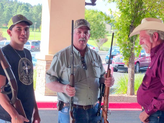 These customers seem satisfied with their purchases at the annual gun and collectible show.