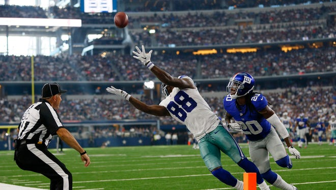 Dallas Cowboys wide receiver Dez Bryant (88) misses a possible touchdown catch as New York Giants cornerback Janoris Jenkins (20) defends at AT&T Stadium on Sunday.