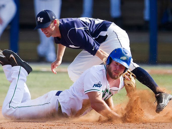 FGCU's Michael Suchy attempts to steal second base against North Florida on Wednesday at Swanson Stadium.