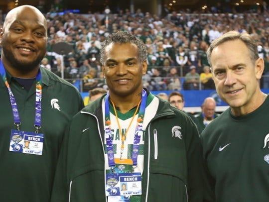 Dixon Edwards, flanked by former Spartan, Flozell Adams