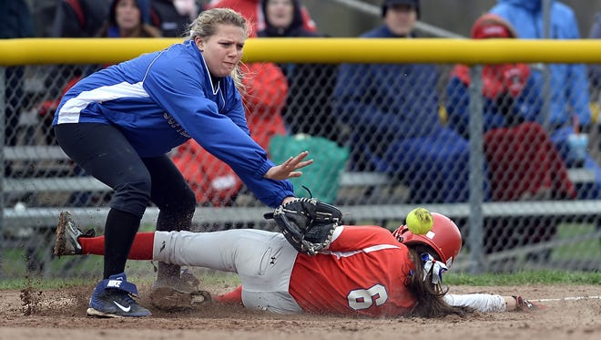 Webster Schroeder's Lauren Patane, left, reaches for the ball as Fairport's Shannon Horan slides safely into third base.