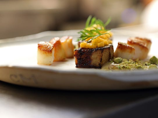 House cured hickory smoked bacon, pan seared Nantucket bay scallops, toasted pistachios and pickled butternut  at The Twisted Oak.