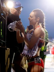 Jenny Simpson signs autographs after winning the 2 Mile and setting a new outdoor world record at the Drake Relays Friday, April 27, 2018.