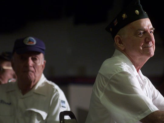 In 2004, Korean War veteran Dick Sayers, right, listens to the comments of Sen. Bob Dole during a televised dedication ceremony for the World War II Memorial in Washington D.C. Local veterans gathered at Harney Point VFW 8463 to watch the event live.