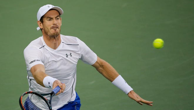 Andy Murray returns a hit to Milos Raonic during the semifinals of the Western and Southern Open at The Lindner Family Tennis Center in Mason Saturday.