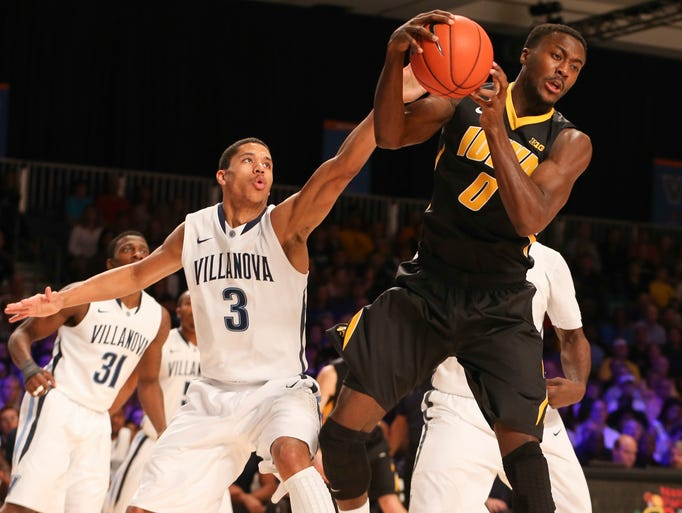 Iowa Hawkeyes center Gabriel Olaseni (0) grabs a rebound away from Villanova Wildcats guard Josh Hart (3) during the first half in the 2013 Battle 4 Atlantis Championship game in the Imperial Arena at the Atlantis Resort.