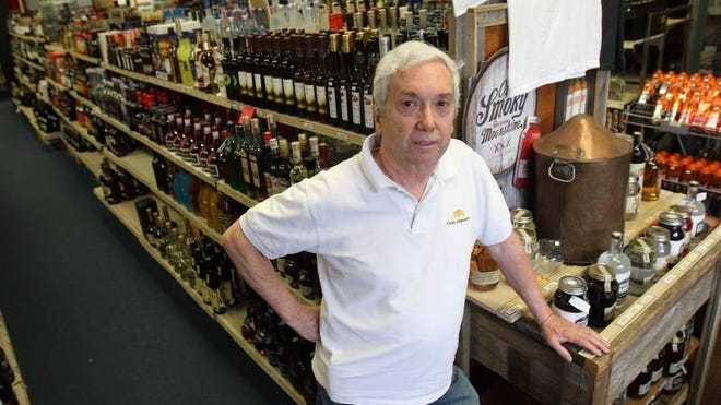 Russell Burlew, owner of Crate's Liquors in Red Bank, was scammed after a caller said he owed money on his electric bill and was about to have his electricity shut off.