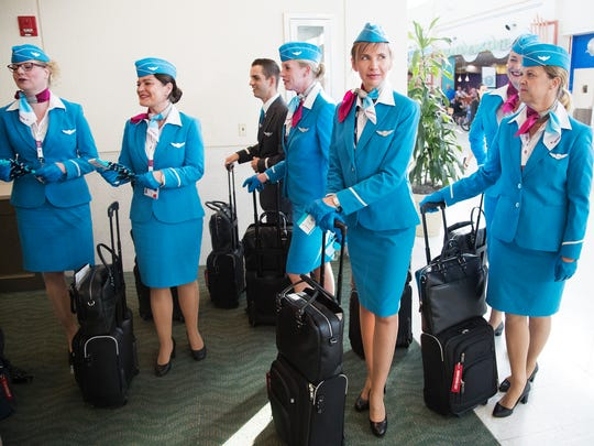 Eurowings flight crew members prepare for service recently at Southwest Florida International Airport (RSW). Eurowings offers flights from Germany to Fort Myers.
