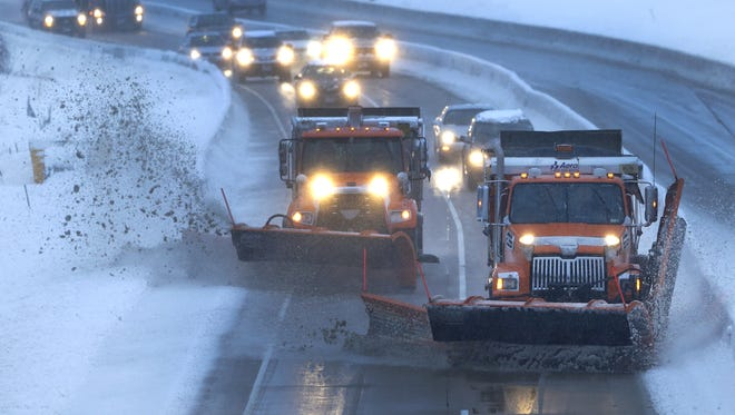 Two Outagamie County plows clear a path Tuesday afternoon for northbound commuters along US 441.