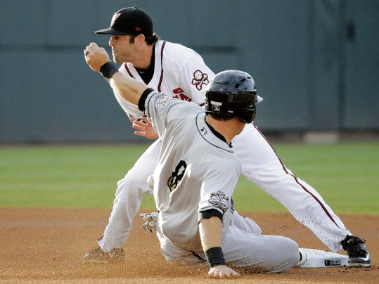 RUBEN R RAMIREZ—EL PASO El Paso Chihuahuas second baseman Casey McElory just misses the play at second base as the ball hits his glove and bounces forward as Omaha Storm Chasers shortstop Dusty Coleman steals second base safely during action of the final game of the current homestand.
