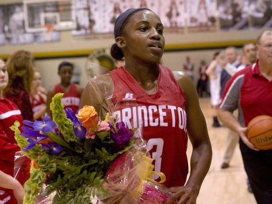 Jackie Young heads into the stands to give her mom the flowers she was presented after beating the Indiana state scoring record.