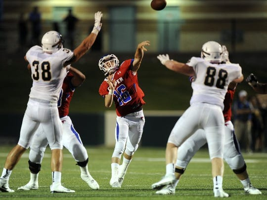 Thomas Metthe/Reporter-News Cooper quarterback Ender Freeman (16) throws a pass during the second quarter of the Action Zone Champions Classic on Friday, Aug. 26, 2016, at Shotwell Stadium.