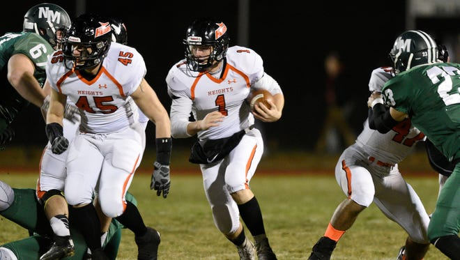 Hasbrouck Heights quarterback James Klenk runs with the ball in the first quarter in the North 1, Group 1 semifinal game vs. New Milford.