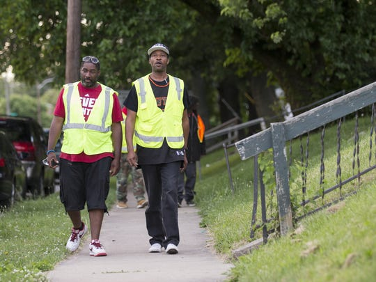 Allan Umphrey (left), and Wallace Nash walk near 40th Street and Boulevard Place, Ten Point Coalition, Indianapolis, Tuesday, June 7, 2016.