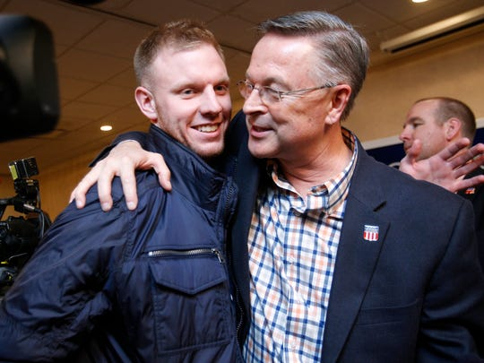 Republican businessman Rod Blum is congratulated by Chad Welsh, left, a former basketball player under Blum, after being elected in northeast Iowa's 1st district, beating longtime Democratic state Rep. Pat Murphy Wednesday, Nov. 5, 2014, in Dubuque, Iowa. (AP Photo/Waterloo Courier, Tiffany Rushing)