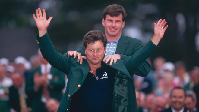 Ian Woosnam receives the green jacket from Nick Faldo after winning the 1991 Masters.