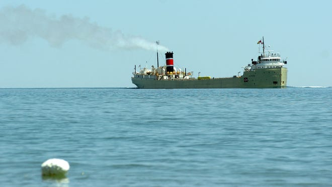 The freighter Alpena heads downbound in Lake Huron. It was built in 1942 and is powered by a steam turbine — one of the few steamships left on the Great Lakes.