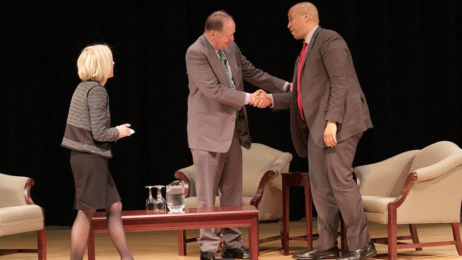 Gov. Tom Kean and Sen. Cory Booker take part in the United Way's Public Officials Forum at the College of St. Elizabeth, moderated by Kate Tomlinson, Friday, November 20, 2015. Morristown, NJ.