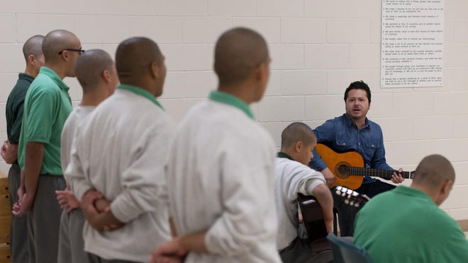 Carlos Rodriguez of Mezcal teaches guitar to youth at Tulare County Probation Youth Facility on Monday, December 14, 2015. Students must behave in and out of all classes to participate in the extracurricular activity.