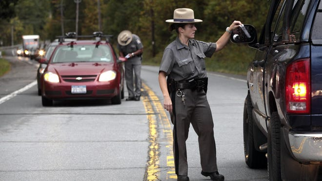 State troopers search for suspect Richard Giga at a roadblock in 2010 near Ellenville. Giga fatally stabbed a security guard at an upstate drug and alcohol rehabilitation center and abducted a night nurse.