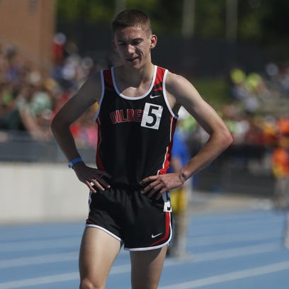 Gilbert's Thomas Pollard crosses the finish Thursday,