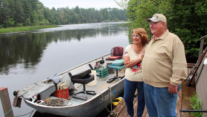 Ralph and Angie Basile, both 82 years old, stand on their dock along the Tomahawk River. Due to age and health concerns, the couple sold their Northwoods home, which has been their full-time residence since 2000 and sits on land that's been in the Basile family since 1949, to be near four of their seven children in Rockford, Ill.