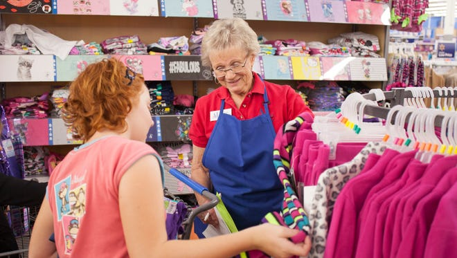 Members of the Assistance League help area students pick out clothes at the Washington City Wal-Mart Thursday, Oct. 29, 2015.