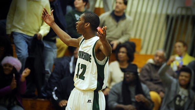Parkside forward Raequan Williams calls on the crowd to applaud the Rams for their playoff win over Wi-Hi on Thursday, March 2, 2017.