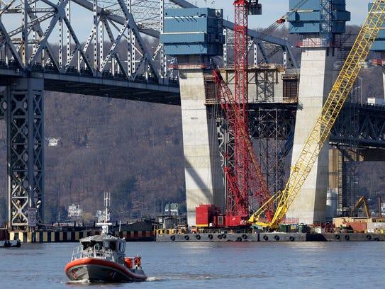 A Coast Guard boat passes near the site of a fatal