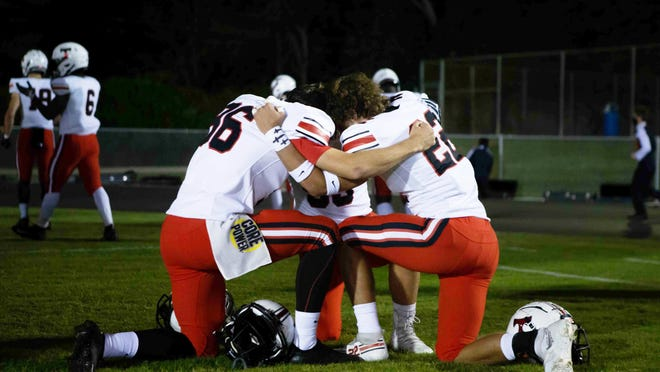 North Oconee players pray before a game against Cedar Shoals earlier this month.