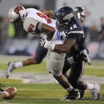 Nevada's Kaelin Burnett sacks UNLV's quarterback Caleb Herring during the 2011 game bewteen Nevada and UNLV, the only shutout in the rival's history.