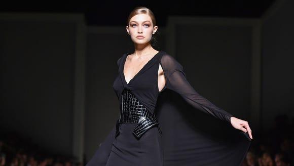 Gigi Hadid takes a twirl on the Tom Ford runway on
