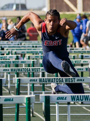 Brookfield East senior Abel Christiansen competes in the 110 meter hurdles during the Greater Metro Conference Outdoor Track & Field Championships at Wauwatosa West on Tuesday, May 15, 2018. Christiansen won the event with a time of 14.71.