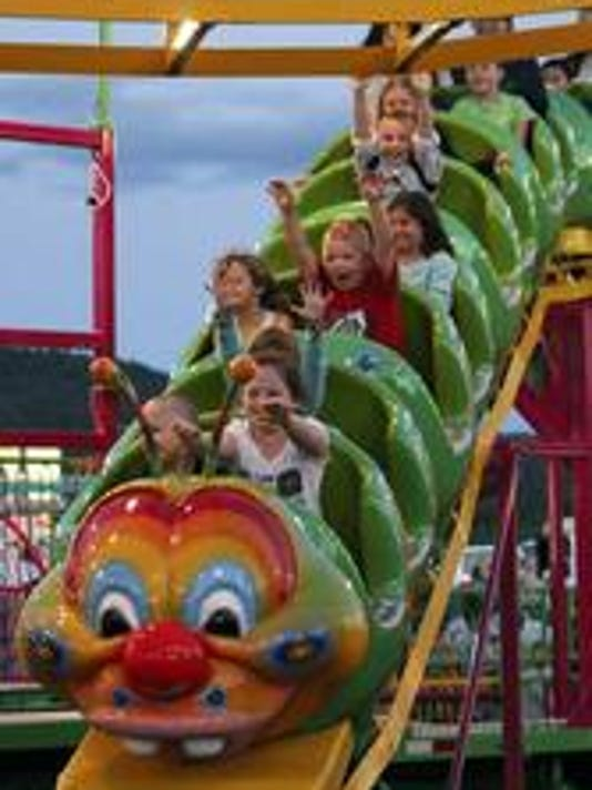 Children ride a caterpillar-themed rollercoaster at the 39th annual Mont Alto Carnival in June 2014.