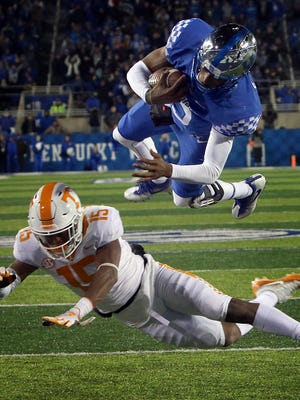 "University of Kentucky's Stephen Johnson is ""Superman"" as he flies over a Tennessee defender for a late touchdown against Tennessee."