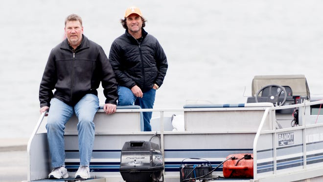 Brian Niekerk and Mack Schmidt sit atop their boat for a portrait in Kingston, Tennessee on Wednesday, March 7, 2018. Brian Niekerk and Mack Schmidt launched their company Lake Weed Controls to combat invasive aquatic plants like hydrilla in residential and commercial waterfront properties.