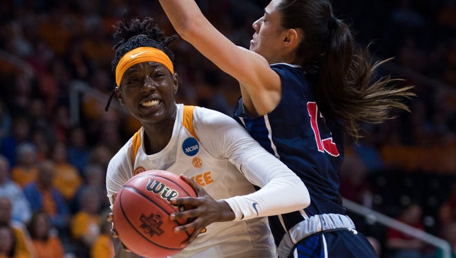 Tennessee's Rennia Davis (0) takes a shot while defended by Liberty's Melis Ucar (13) on Friday.