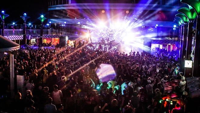 Music fans enjoy a concert aboard a Sixthman music cruise.