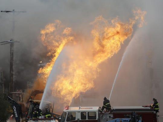 San Francisco fire fighters battle a fire on Geary