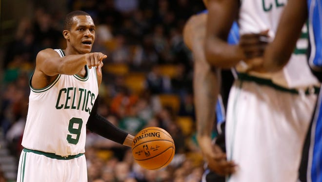 Celtics guard Rajon Rondo (9) looks for an opening against the Orlando Magic in the second half at TD Garden.