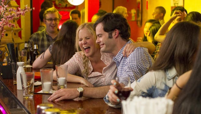 """Amy Schumer and Bill Hader star in the comedy """"Trainwreck""""."""