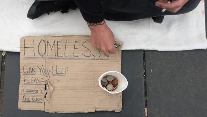 A homeless man sits in Edinburgh, Scotland.